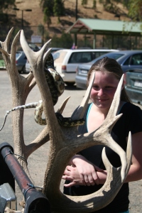 Sarah Kielbaska fascinated by the snake twined around a deer antler